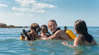 The Cousteau family in the sea in a scene from the film