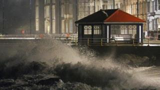 Waves crash against the sea wall in Aberystwyth in west Wales as Storm Eleanor hits the UK causing power cuts and road disruption