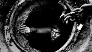 Workers Cleaning Sewer