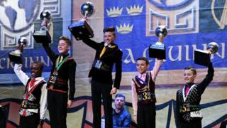 Winners receiving their trophies