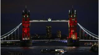 London's Tower Bridge is illuminated in blue, white and red lights