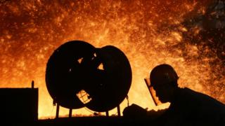 A steel worker labours in front of a blast furnace at the Chongqing Iron and Steel Factory on September 16, 2006 in Chongqing Municipality, China