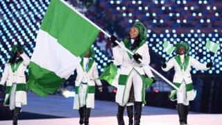 Flag bearer Ngozi Onwumere of Nigeria leads the team during the Opening Ceremony