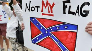A sign held up during a protest rally against the Confederate battle flag in South Carolina, USA
