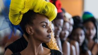 Model Winfrida Metili, from Dar es Salaam, presents a creation during the opening night of the Swahili Fashion Week in Dar es Salaam,Tanzania on December 2, 2016