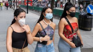 As Britain enters a period of deep recession, with some shops closing either temporarily or permanently as the economic downturn caused by the Covid-19 pandemic cuts hard, shoppers wearing face masks continue to come to the West End to Oxford Street on 13th August 2020 in London, United Kingdom.