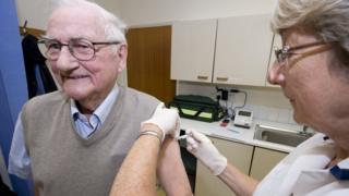 Elderly male gets influenza jab