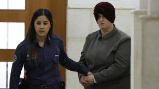 In this file photo taken on February 27, 2018 Malka Leifer, a former Australian teacher accused of dozens of cases of sexual abuse of girls at a school, arrives for a hearing at the District Court in Jerusalem