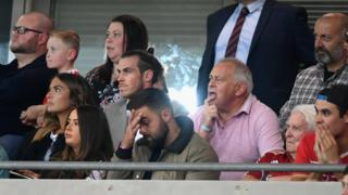 Gareth Bale watching match from stands
