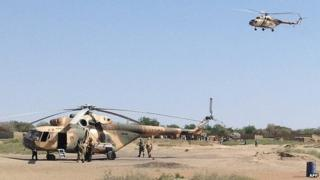 Mi-8 attack helicopters are seen in Fotokol, Cameroon, on February 1, 2015, after an operation in nearby Gamboru, Nigeria
