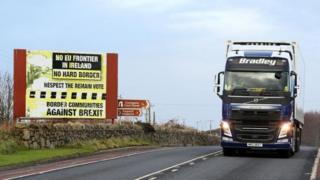Traffic passing a Brexit Border poster on the Dublin road Co Armagh border