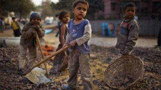 Indian children work nearby to their parents at a construction project in front of the Jawaharlal Nehru Stadium on January 30, 2010 in New Delhi, India.