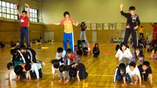 Japanese children building human pyramids