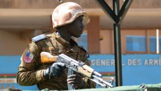 A soldier stand guard outside the headquarters of the country's defence forces in the capital Ouagadougou