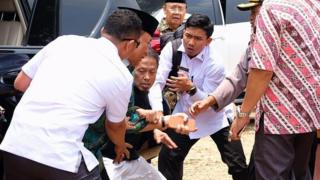 A man stabbing Indonesian Security Minister Wiranto during his visit in Pandeglang, Indonesia,