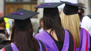 Three students in mortar boards