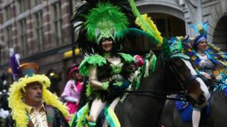 Women in costume on horses