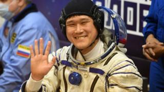 Космонавт Норишиге Канаи