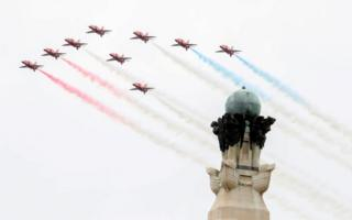 The Red Arrows perform a flypast