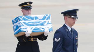 Soldiers carrie caskets containing remains of US soldiers who were killed in the Korean War during a ceremony at Osan Air Base in Pyeongtaek, South Korea, 27 July 2018.
