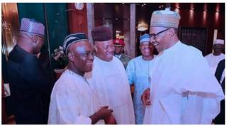 President Muhammadu Buhari, senator Ita Enang and senator Godwill Akpabio dey gist.