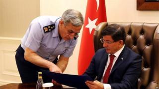 Turkish PM Ahmet Davutoglu (r) is briefed by Turkish Air Force commander Gen Akin Ozturk, 25 July 2015