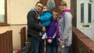 Mark and Cerys Jenkins with children Sami, 11 and Lewi, two
