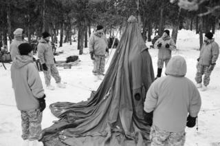 Staff Sergeant Ben Kueter instructs recruits how to erect a ten man tent