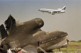 Tail section of a Delta L-1011 jetliner remains near the runway at the Dallas-Fort Worth International Airport, Aug. 3, 1985