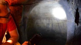 Scott Lomax inspects a cave in Nottingham