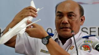 Chief of Indonesian transportation safety committee Soerjanto Tjahjono holds an aircraft model as he speaks to journalists during a press conference in Jakarta, Indonesia, 01 December 2015