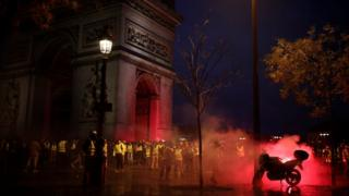 """Protesters wearing yellow vests, a symbol of a French drivers"""" protest against higher diesel taxes, gather at the Place de l""""Etoile near the Arc de Triomphe in Paris, France, December 1, 2018"""