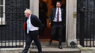 Boris Johnson and Jeremy Hunt leave 10 Downing Street.
