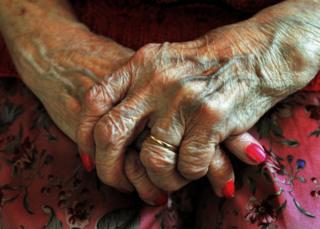 Hands of elderly woman