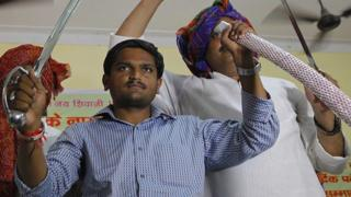 Hardik Patel, Convener of Patidar Anamat Andolan Samiti (PAAS) being felicitated by Gurjar Community at Kotla Village, Gurjar Bhawan near Patparganj, on August 30, 2015 in New Delhi, India. Patel announced that he won't allow any political party to join his agitation and he wants to turn the stir into a national movement.