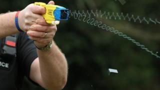 Police officer using a Taser