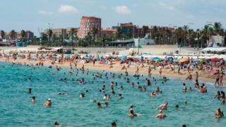 Swimmers on the beach in Spain