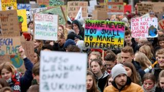 High school students demonstrate against global warming at a Fridays for Future demonstration on March 01, 2019 in Hamburg, Germany.