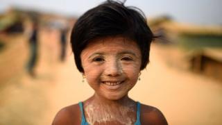 Rohingya refugee Nur Kayas, aged 6, poses for a photograph as she wears thanaka paste at Kutupalong camp in Cox's Bazaar, Bangladesh