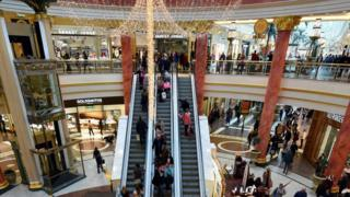 Shoppers on the escalator at Trafford centre