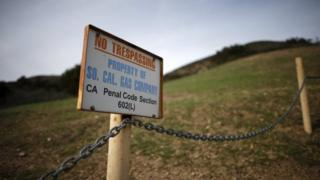 A gas company sign marks a fence near the site of the Aliso Canyon storage field where gas has been leaking in Porter Ranch, California, United States, 21 January 2016.