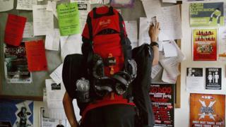 Backpacker at jobs board