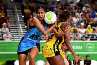 Unouna Rusivakula of Fiji competes against Jamaica in netball