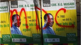Posters for President Robert Mugabe are covered with graffiti for the opposition Movement for Democratic Change in Harare, Zimbabwe - 27 June 2008