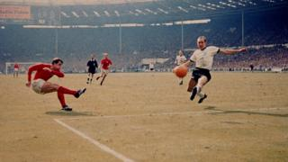 Geoff Hurst scores England's third goal against West Germany in the World Cup final at Wembley Stadium