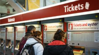Tourists buy tickets at London Liverpool Street station