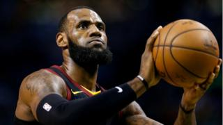 LeBron James attempts a free throw against the Boston Celtics during the first quarter of game five of the Eastern conference finals of the 2018 NBA Playoffs, 23 May 2018