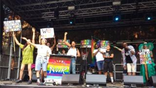 A group of people on stage at a Rainbow Noir event