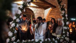 A North Macedonian Orthodox priest leads a midnight Easter service in the village of Kalishta