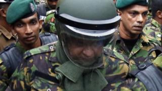 Bodyguard fires at crowd in Sri Lanka crisis